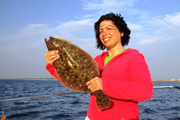 Felicia Scozozza caught this solid fluke in the waters due south of Shinnecock Inlet. With a new 18-inch minimum size limit in effect for 2014, New York anglers no longer have to catch mini-doormats to put some fillets on ice.
